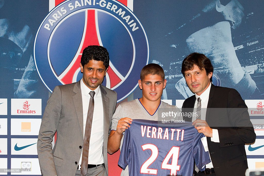 Marco Verratti (C) attends a press conference with Paris Saint-Germain chairman Nasser Al-Khelaifi (L) and PSG's sporting director Leonardo, as Verratti signs for Paris Saint-Germain, on July 18, 2012 in Paris, France.