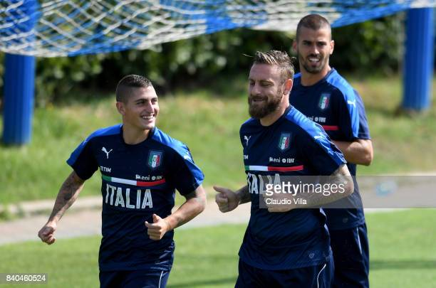 Marco Verratti Daniele De Rossi and Leonardo Spinazzola of Italy in action during the traning session at Coverciano on August 29 2017 in Florence...