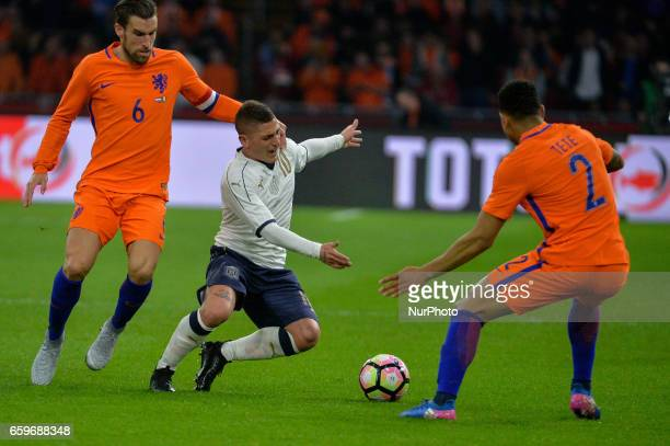 Marco Verratti from Italy is challenged by Kevin Strootman and Kenny Tete from the Netherlands during the friendly match between Netherlands and...