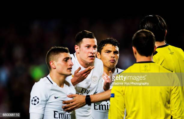 Marco Verratti Julian Draxler and Thiago Silva of PSG discuss with referee Deniz Aytekin after his call on a penalty kick during the UEFA Champions...