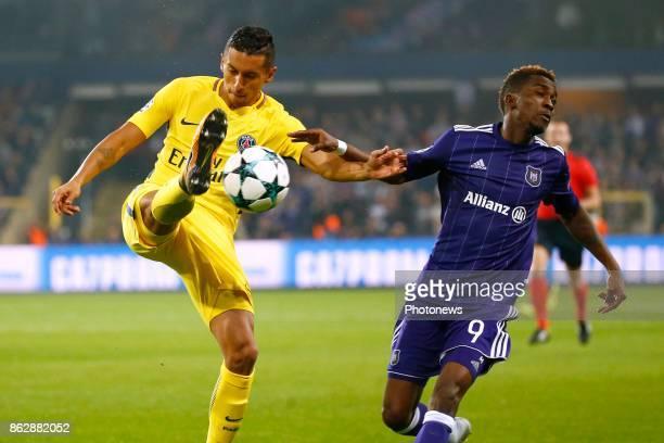 Marco Verratti midfielder of PSG and Henry Onyekuru forward of RSC Anderlecht during the Champions League Group B match between RSC Anderlecht and...