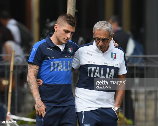 Marco Verratti of Italy and Italy Doctor Enrico Castellacci chat prior to the training session at Coverciano at Coverciano on June 05 2017 in...