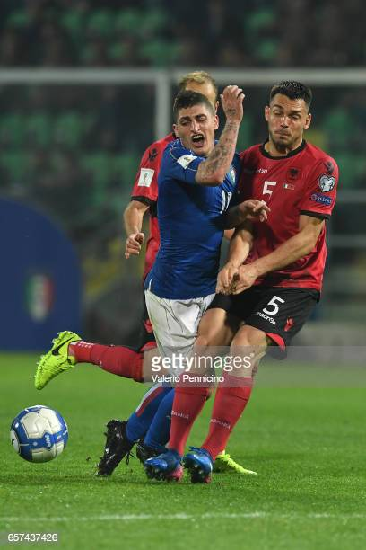 Marco Verratti of Italy clashes with Frederic Veseli of Albania during the FIFA 2018 World Cup Qualifier between Italy and Albania at Stadio Renzo...
