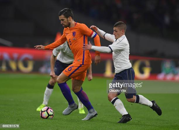 Marco Verratti of Italy competes for the ball with Kevin Strootman of Netherlands during the international friendly match between Netherlands and...
