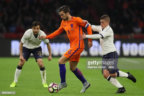 Marco Verratti of Italy competes with Kevin Strootman of Netherlands during the international friendly match between Netherlands and Italy at...