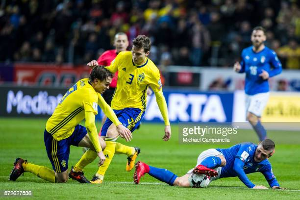 Marco Verratti of Italy keeps the ball away from Victor Nilsson Lindelof and Albin Ekdal of Sweden during the FIFA 2018 World Cup Qualifier PlayOff...
