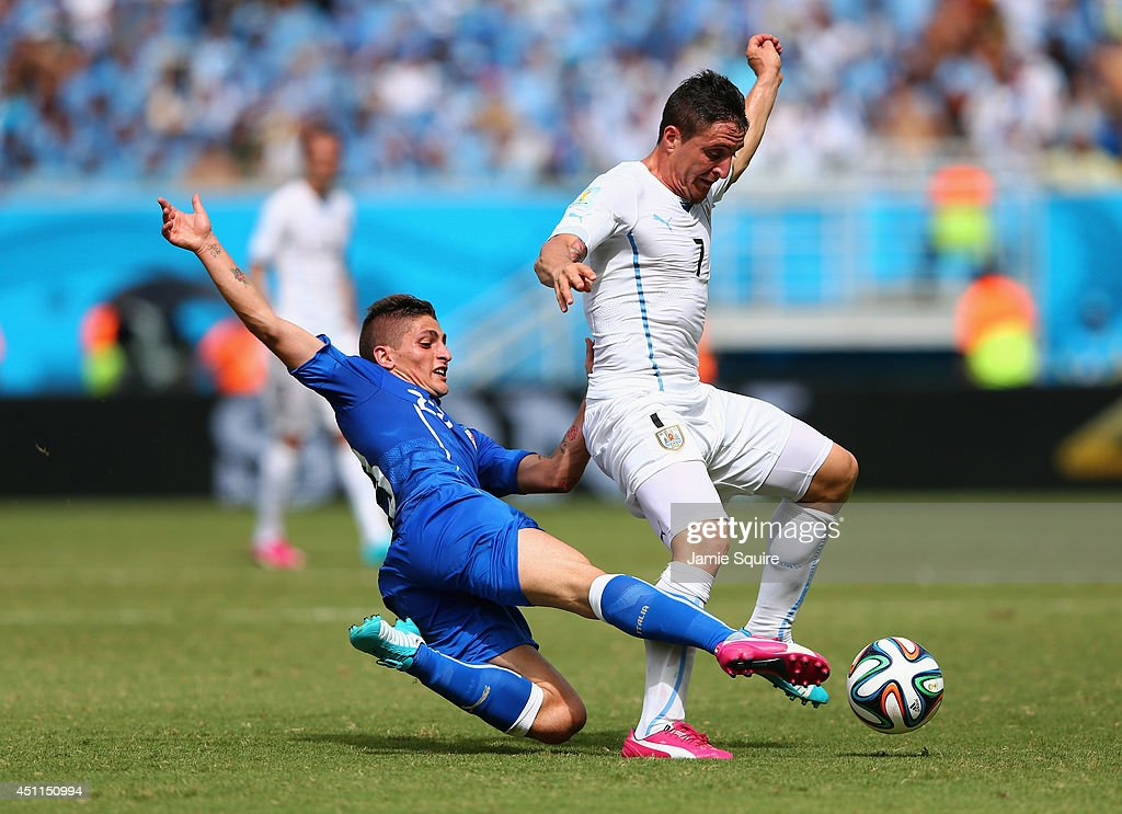 <a gi-track='captionPersonalityLinkClicked' href=/galleries/search?phrase=Marco+Verratti&family=editorial&specificpeople=7256509 ng-click='$event.stopPropagation()'>Marco Verratti</a> of Italy tackles Cristian Rodriguez of Uruguay during the 2014 FIFA World Cup Brazil Group D match between Italy and Uruguay at Estadio das Dunas on June 24, 2014 in Natal, Brazil.