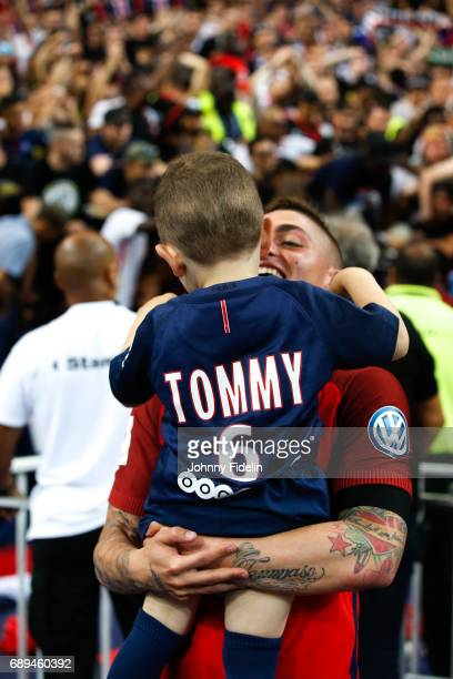 Marco Verratti of Paris Saint Germain celebrate the victory with his son Tommy after winning the National Cup Final match between Angers SCO and...