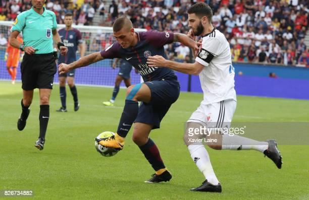 Marco Verratti of Paris SaintGermain in action with captain Thomas Monconduit of Amiens SC during the French Ligue 1 match between Paris Saint...