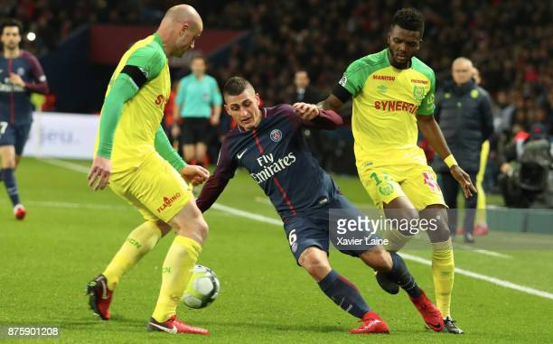 Marco Verratti of Paris SaintGermain in action with Nicolas Pallois and Chidozie Awaziem of FC Nantes during the Ligue 1 match between Paris...