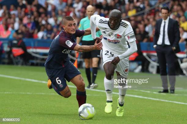 Marco Verratti of Paris SaintGermain in action with Seybou Koita of Amien SC during the French Ligue 1 match between Paris Saint Germain and Amiens...