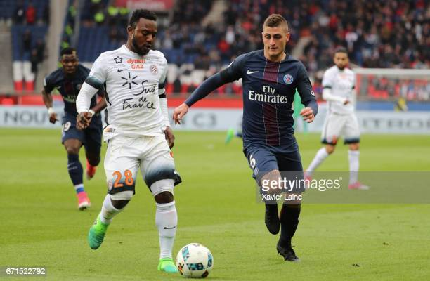 Marco Verratti of Paris SaintGermain in action with Stephane Sessegnon of Montpellier of Montpellier during the French Ligue 1 match between Paris...