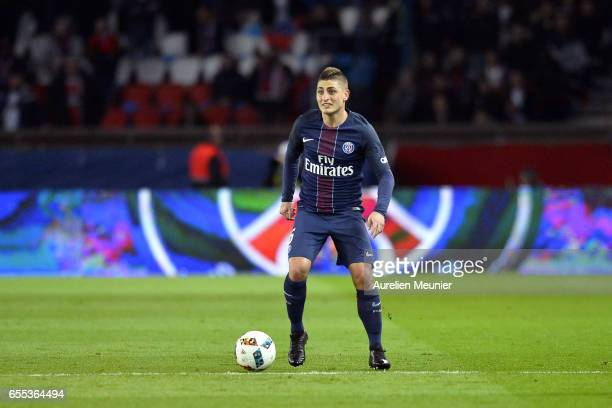 Marco Verratti of Paris SaintGermain runs with the ball during the French Ligue 1 match between Paris Saint Germain and Lyon at Parc des Princes on...