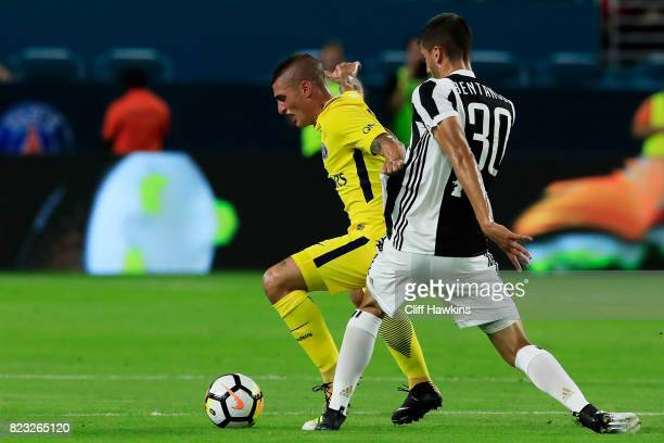 Marco Verratti of Paris SaintGermain vie for possession with Rodrigo Bentancur of Juventus in the first half during their International Champions Cup...