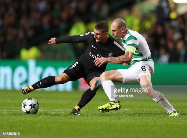 Marco Verratti of Paris SaintGermain vies with Scott Brown of Celtic during the UEFA Champions League Group B match Between Celtic and Paris...