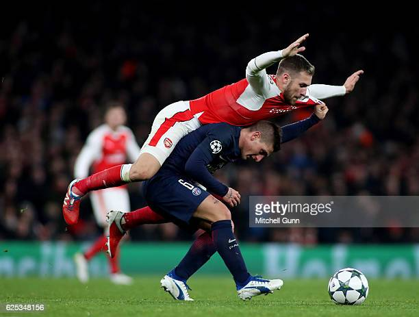 Marco Verratti of PSG and Aaron Ramsey of Arsenal compete for the ball during the Champions League match between Arsenal and Paris SaintGermain at...