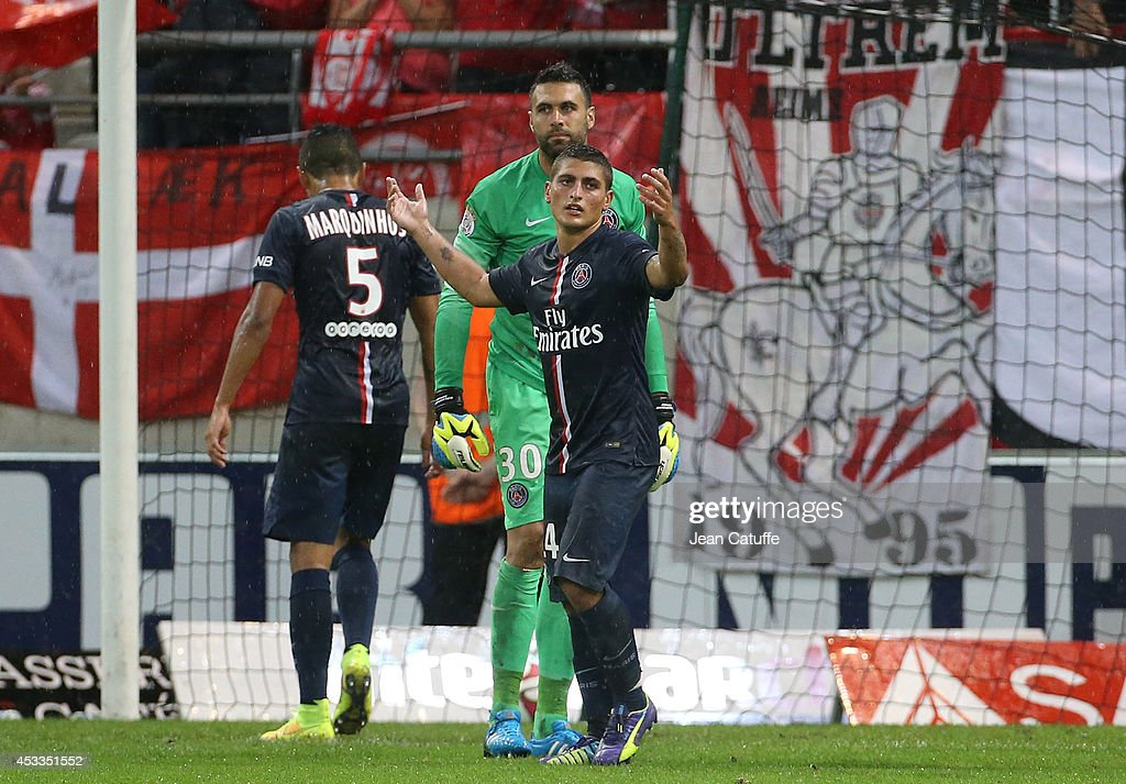 Marco Verratti of PSG and goalkeeper of PSG Salvatore Sirigu react after conceding a goal from Reims during the French Ligue 1 match between Stade de Reims and Paris Saint Germain FC at the Stade Auguste Delaune on August 8, 2014 in Reims, France.