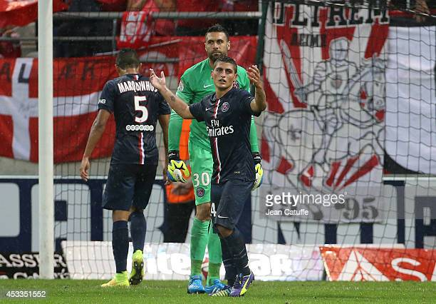 Marco Verratti of PSG and goalkeeper of PSG Salvatore Sirigu react after conceding a goal from Reims during the French Ligue 1 match between Stade de...