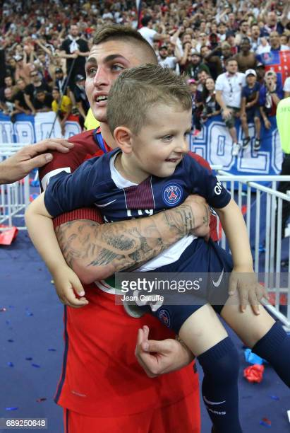 Marco Verratti of PSG and his son Tommaso Verratti following the French Cup final between Paris SaintGermain and SCO Angers at Stade de France on May...