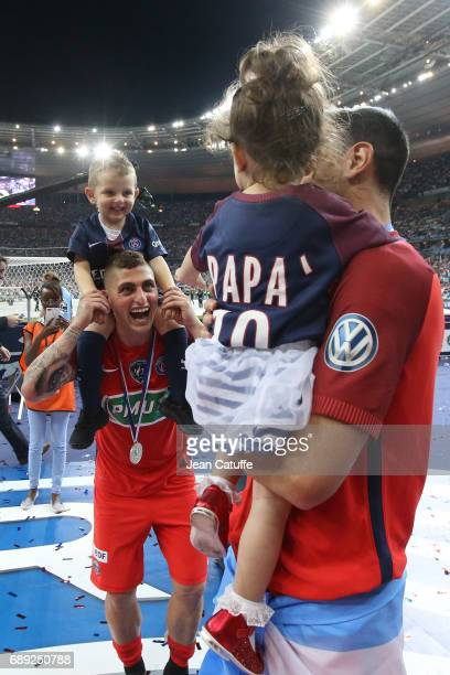 Marco Verratti of PSG and his son Tommaso Verratti with Javier Pastore and daughter celebrate the victory following the French Cup final between...