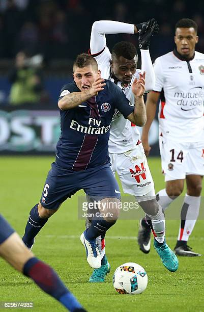 Marco Verratti of PSG and Jean Michael Seri of Nice in action during the French Ligue 1 match between Paris Saint Germain and OGC Nice at Parc des...