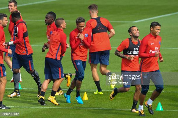 Marco Verratti of PSG and Neymar Jr of PSG and Dani Alves of PSG and Thiago Silva of PSG during the training session of Paris Saint Germain on August...
