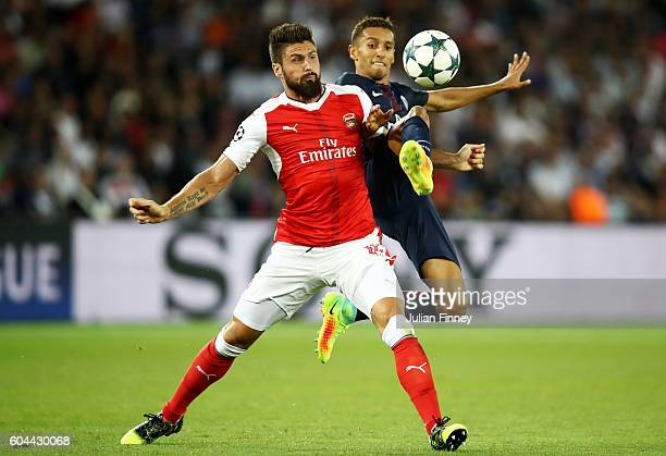 Marco Verratti of PSG and Olivier Giroud of Arsenal in action during the UEFA Champions League Group A match between Paris SaintGermain and Arsenal...