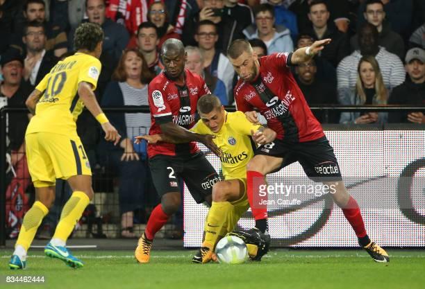 Marco Verratti of PSG between Jordan Ikoko and Lucas Deaux of Guingamp during the French Ligue 1 match between En Avant Guingamp and Paris Saint...