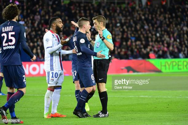 Marco Verratti of PSG demands that referee Clement Turpin shows Memphis Depay of Lyon a yellow card for diving in the penalty area during the French...