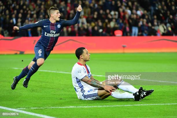 Marco Verratti of PSG demands that the referee shows Memphis Depay of Lyon a yellow card for a dive during the French Ligue 1 match between Paris...