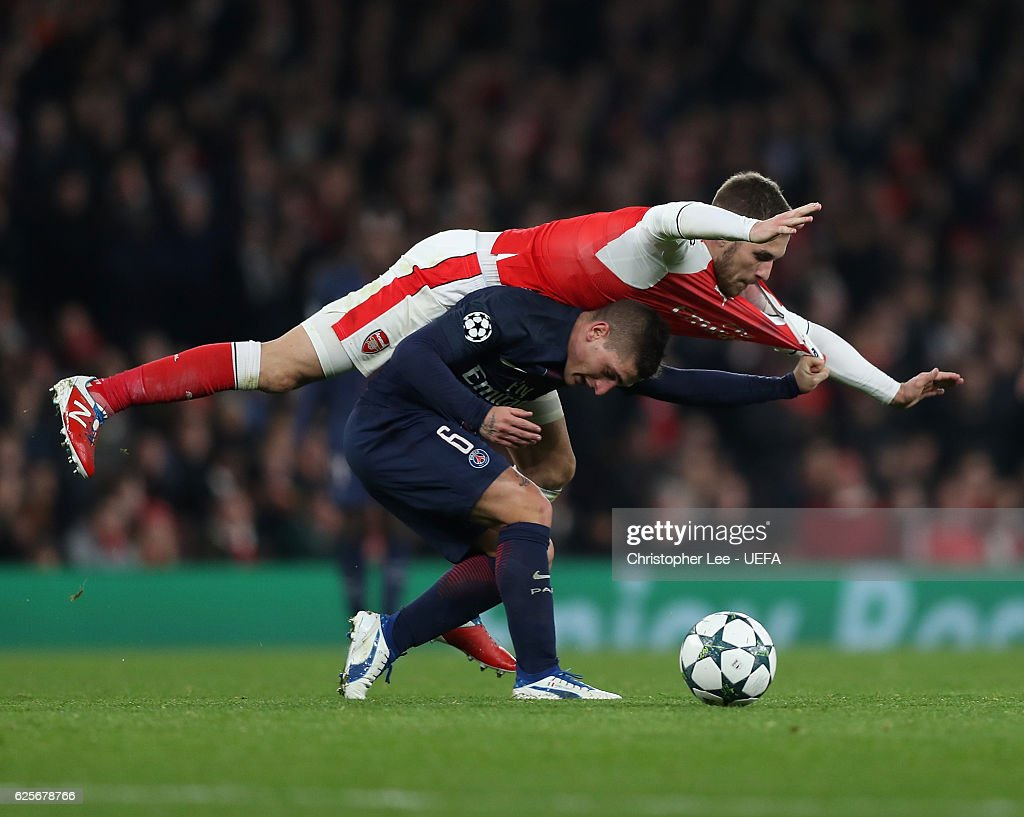 Marco Verratti of PSG is below Aaron Ramsey of Arsenal as they battle for the ball during the UEFA Champions League match between Arsenal FC and Paris Saint-Germain at Emirates Stadium on November 23, 2016 in London, England.