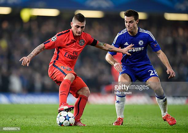 Marco Verratti of PSG is challenged by Cesar Azpilicueta of Chelsea during the UEFA Champions League Round of 16 second leg match between Chelsea and...