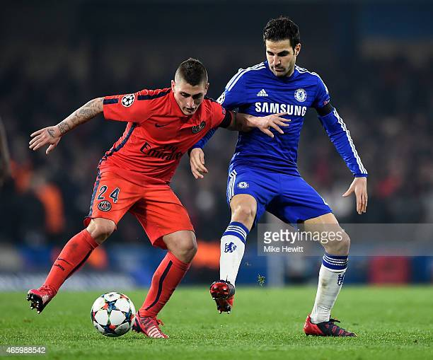 Marco Verratti of PSG is challenged by Cesc Fabregas of Chelsea during the UEFA Champions League Round of 16 second leg match between Chelsea and...