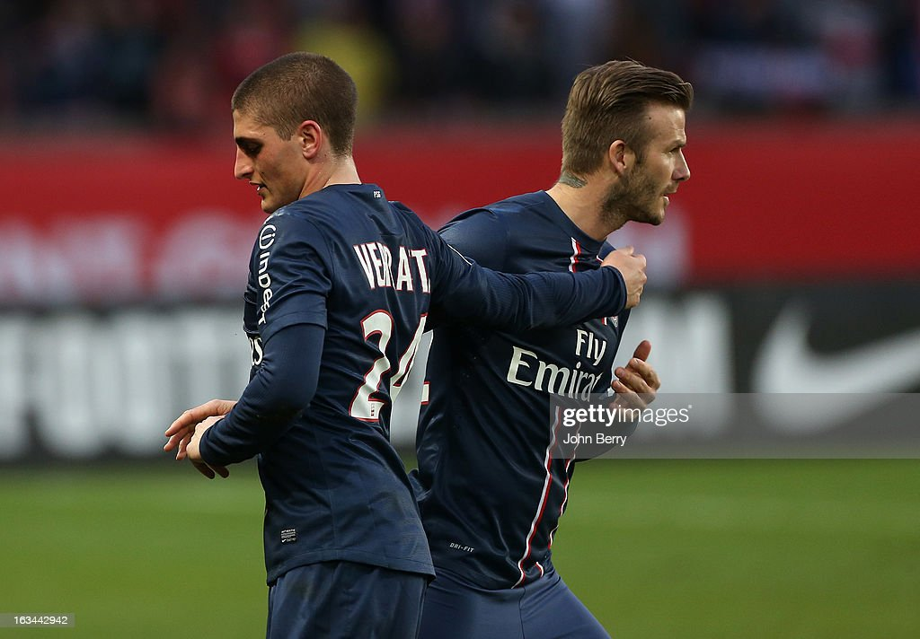 Marco Verratti of PSG is substituted by David Beckham during the french Ligue 1 match between Paris Saint-Germain FC and AS Nancy-Lorraine ASNL at the Parc des Princes stadium on March 9, 2013 in Paris, France.