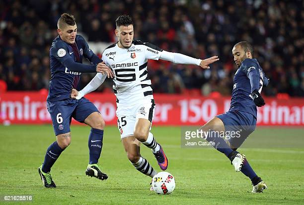 Marco Verratti of PSG Ramy Bensebaini of Rennes Lucas Moura of PSG in action during the French Ligue 1 match between Paris SaintGermain and Stade...