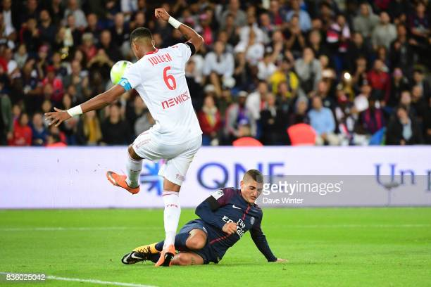 Marco Verratti of PSG receives a second yellow card for this challenge on Christopher Jullien of Toulouse during the Ligue 1 match between Paris...