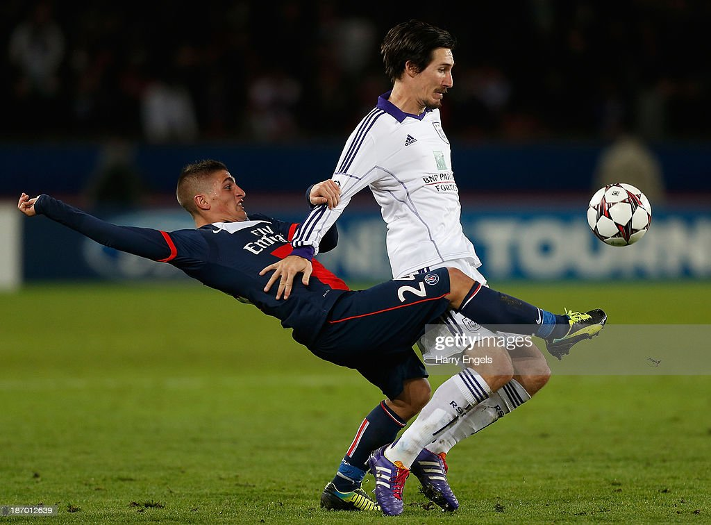 <a gi-track='captionPersonalityLinkClicked' href=/galleries/search?phrase=Marco+Verratti&family=editorial&specificpeople=7256509 ng-click='$event.stopPropagation()'>Marco Verratti</a> of PSG (L) tackles <a gi-track='captionPersonalityLinkClicked' href=/galleries/search?phrase=Sacha+Kljestan&family=editorial&specificpeople=577421 ng-click='$event.stopPropagation()'>Sacha Kljestan</a> of Anderlect during the UEFA Champions League Group C match between Paris Saint Germain and RSC Anderlecht at Parc des Princes on November 5, 2013 in Paris, France.