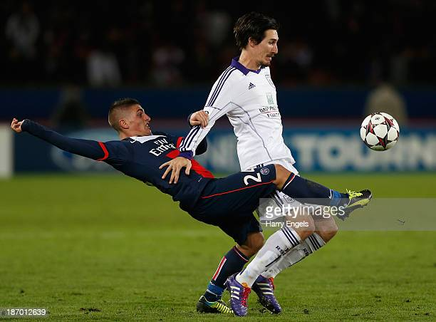 Marco Verratti of PSG tackles Sacha Kljestan of Anderlect during the UEFA Champions League Group C match between Paris Saint Germain and RSC...