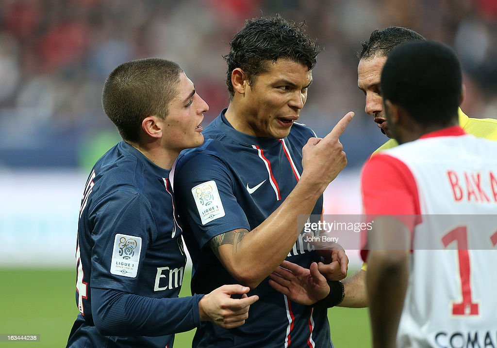 Marco Verratti of PSG tries to calm down Thiago Silva of PSG who is upset with a player of Nancy during the french Ligue 1 match between Paris Saint-Germain FC and AS Nancy-Lorraine ASNL at the Parc des Princes stadium on March 9, 2013 in Paris, France.