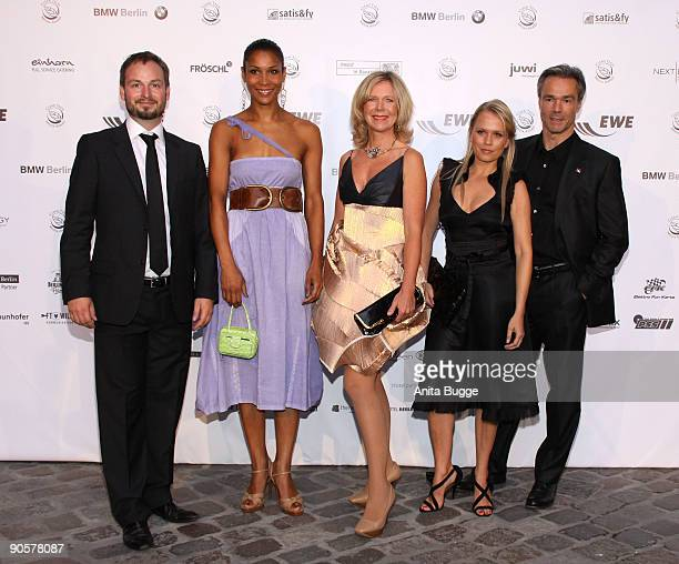 Marco Voigt founder of the Clean Tech Media Award Annabelle Mandeng actress Marion Kracht Nova Meierhenrich and actor Hannes Jaenicke attend the...