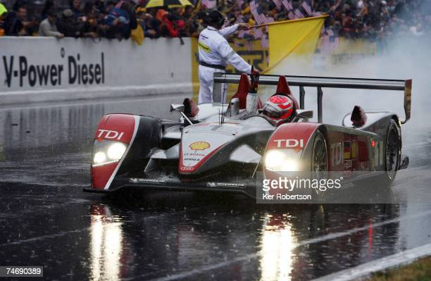 Marco Werner of Germany and Audi Sport celebrates victory for his team at the end of the 75th running of the Le Mans 24 Hour race at the Circuit des...