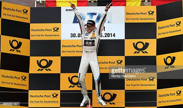 Marco Wittmann of Germany and BMW Team RMG celebrates after winning the third round of the DTM 2014 German Touring Car Championship at Hungaroring on...