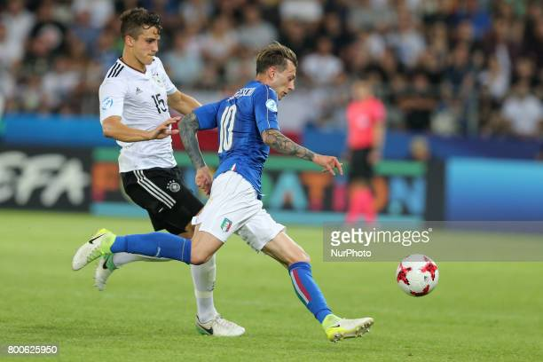 MarcOliver Kempf Federico Bernardeschi during the UEFA U21 European Championship Group C football match Italy v Germany in Krakow Poland on June 24...
