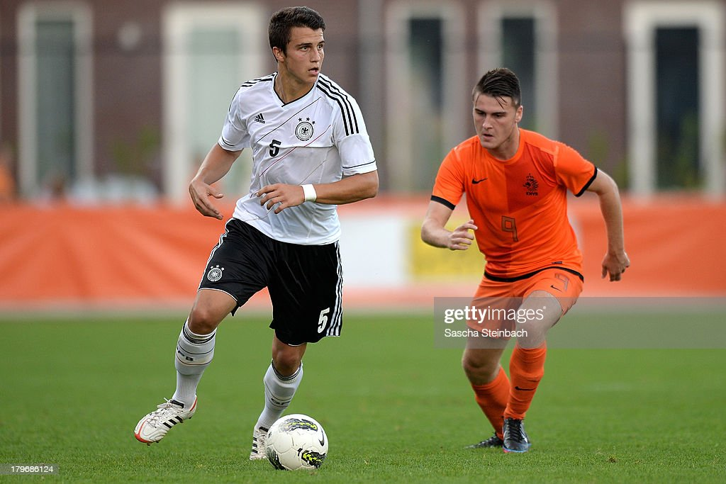 Marc-Oliver Kempf (L) from Germany vies with Sam Hendriks (R) from The Netherlands the ball during the U19 international friendly match between The Netherlands and Germany on September 6, 2013 in Nijmegen, Netherlands.