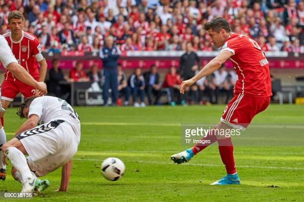 MarcOliver Kempf of Freiburg and Robert Lewandowski of Bayern Muenchen battle for the ball during the Bundesliga match between Bayern Muenchen and SC...