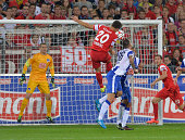 MarcOliver Kempf of Freiburg heads opening goal for Freiburg against Goalkeeper Thomas Kraft and Julian Schieber of Hertha BSC during the Bundesliga...