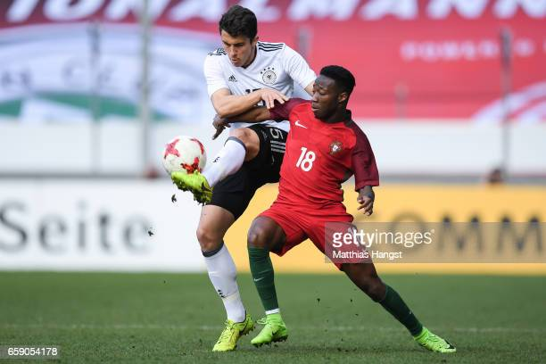 MarcOliver Kempf of Germany and Carlos Mane of Portugal battle for the ball during the U21 International Friendly match between Germany U21 and...