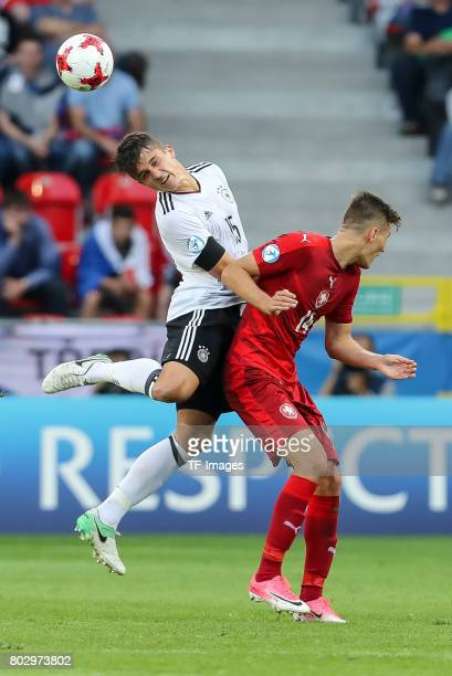 MarcOliver Kempf of Germany and Lukas Kluenter of Germany battle for the ball during the UEFA European Under21 Championship Group C match between...