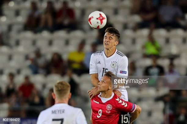 MarcOliver Kempf of Germany and Marcus Ingvartsen of Denmark battle for the ball during the UEFA European Under21 Championship Group C match between...