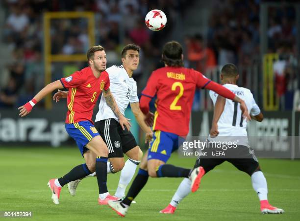 MarcOliver Kempf of Germany and Saul Niguez of Spain watch the ball during the UEFA European Under21 Championship Final between Germany and Spain at...